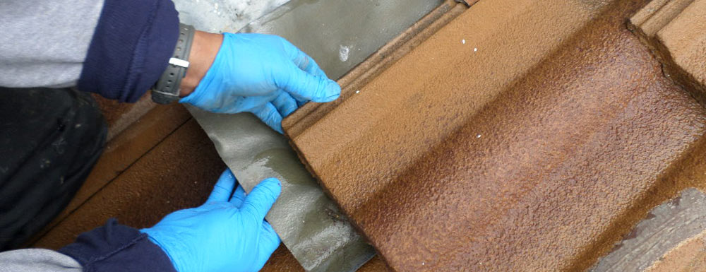 Storm roof leak repair to clay tile roof in San Francisco Bay Area.