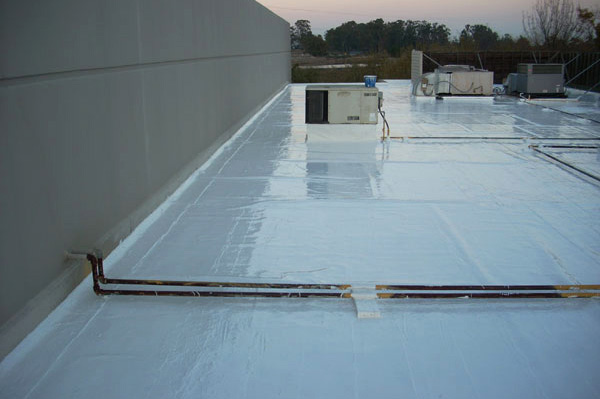 Cool reflective coating on spray foam commercial roof in Sonoma County. The reflective coating is Title 24 compliant.