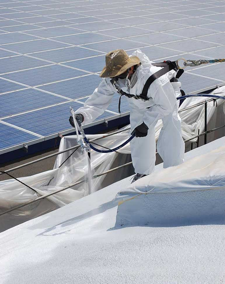 Safely Protected Worker Installs Cool Roof Coating And Spray Foam Roof On  Commercial Building In Sonoma