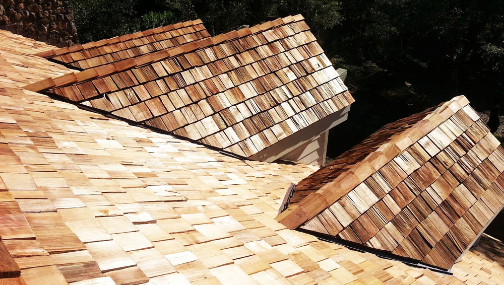 A new fire-treated cedar wood shingle roof installed on a Sonoma County residence