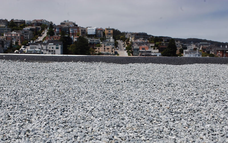 Close up view of tar & gravel built-up roof in San Francisco