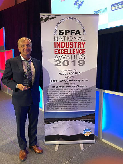 Wedge Roofing accepts 2019 SPFA Award